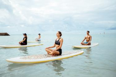 Stand up paddleboard yoga class at Moana Beach